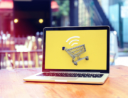 open-laptop-with-yellow-screen-and-shopping-cart-icon
