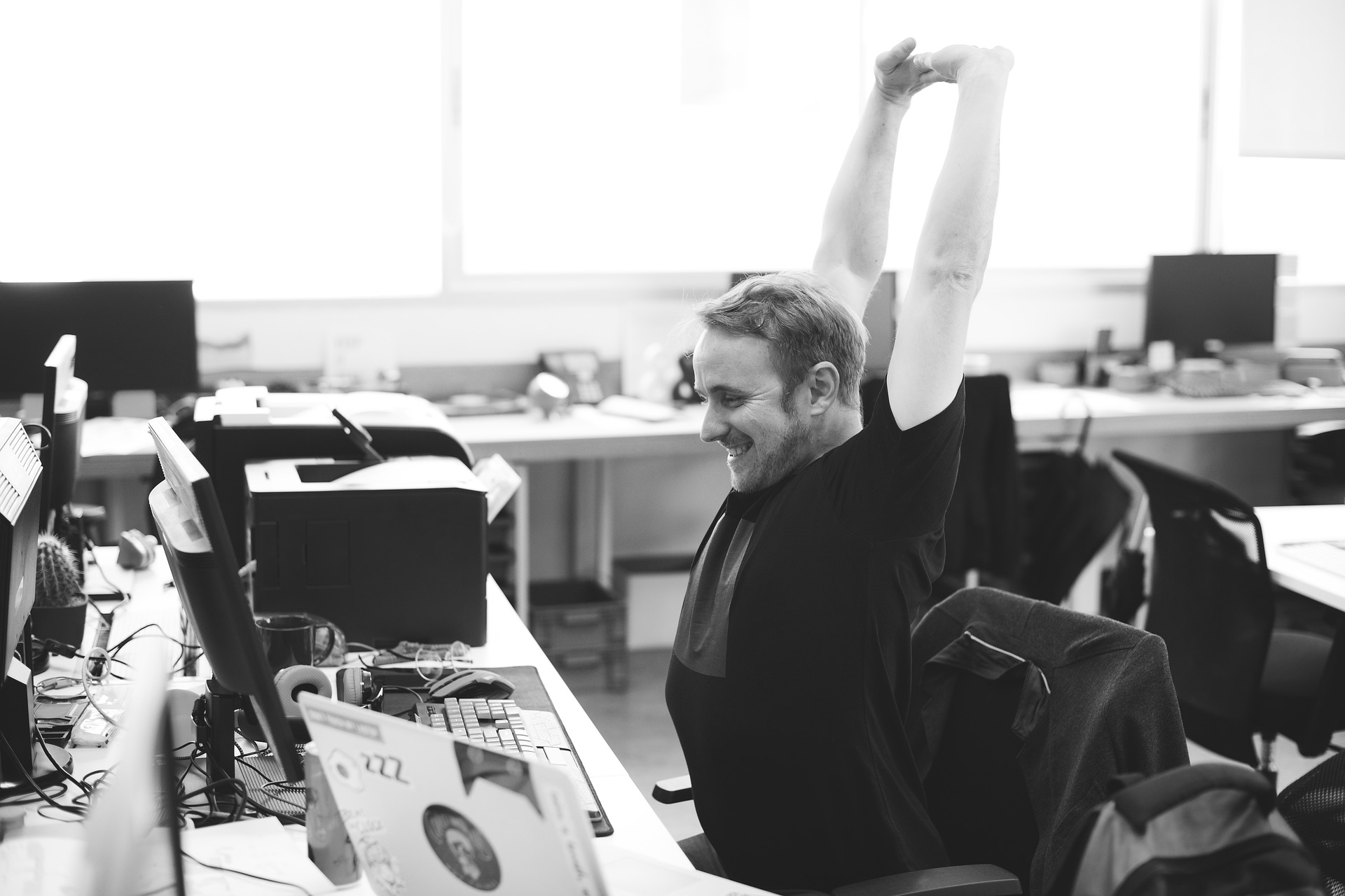 man stretching at workplace
